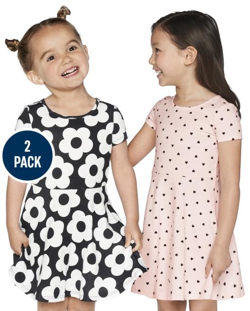 Paquete de 2 vestidos skater de punto con estampado floral y lunares de manga corta para niñas pequeñas