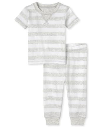Pijamas de algodón ajustados a rayas unisex para bebés y niños pequeños a juego