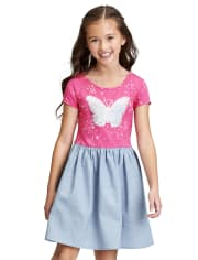 Vestido niña de punto a tejido con mariposa y lentejuelas con solapa