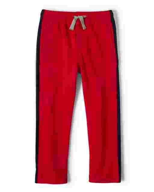 Pantalones deportivos de felpa francesa con rayas laterales para niños