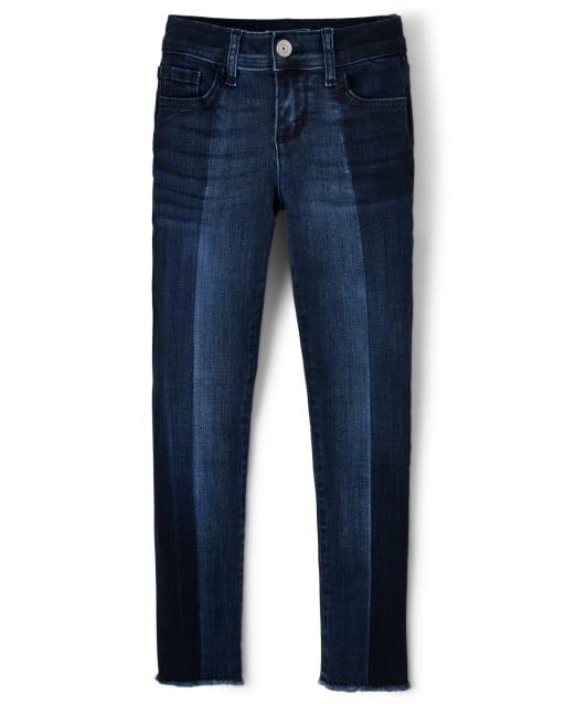 Jeans superajustados de dos tonos con dobladillo escalonado para niñas