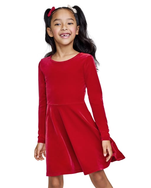 Vestido de niña de manga larga con corte de terciopelo en la espalda